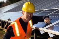man installing solar