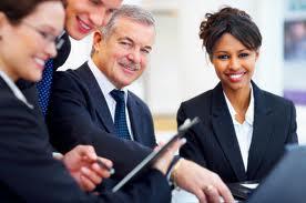 four executives smiling